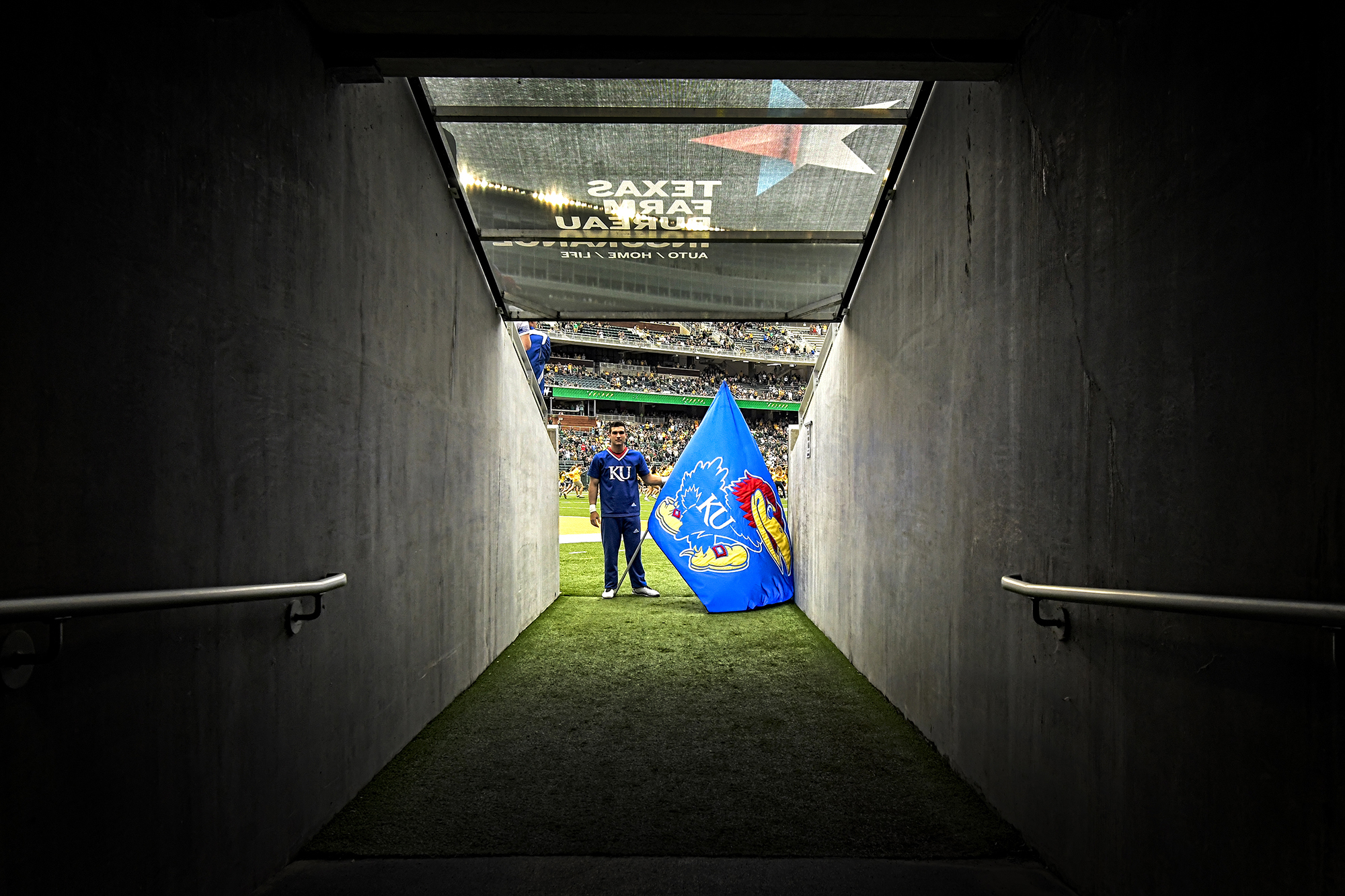 BRING 'EM OUT – Maxwell Simonian waited at the end of a tunnel leading from the KU football locker room where the junior cheerleader would lead the team onto the field inside McLane Stadium on Saturday, September 22, where the Jayhawks battled Baylor in Waco, Texas.