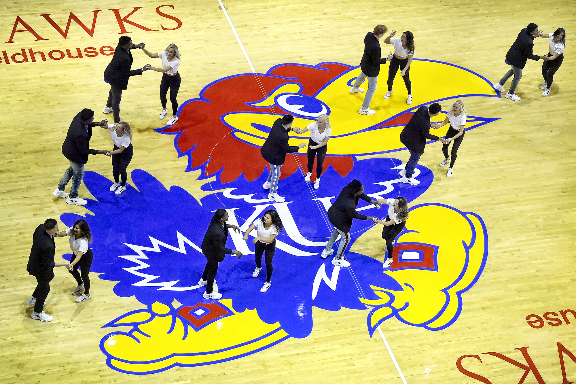 DANCE MEN – Teaming with the Rock Chalk Dancers, the KU men showed off their dance moves.