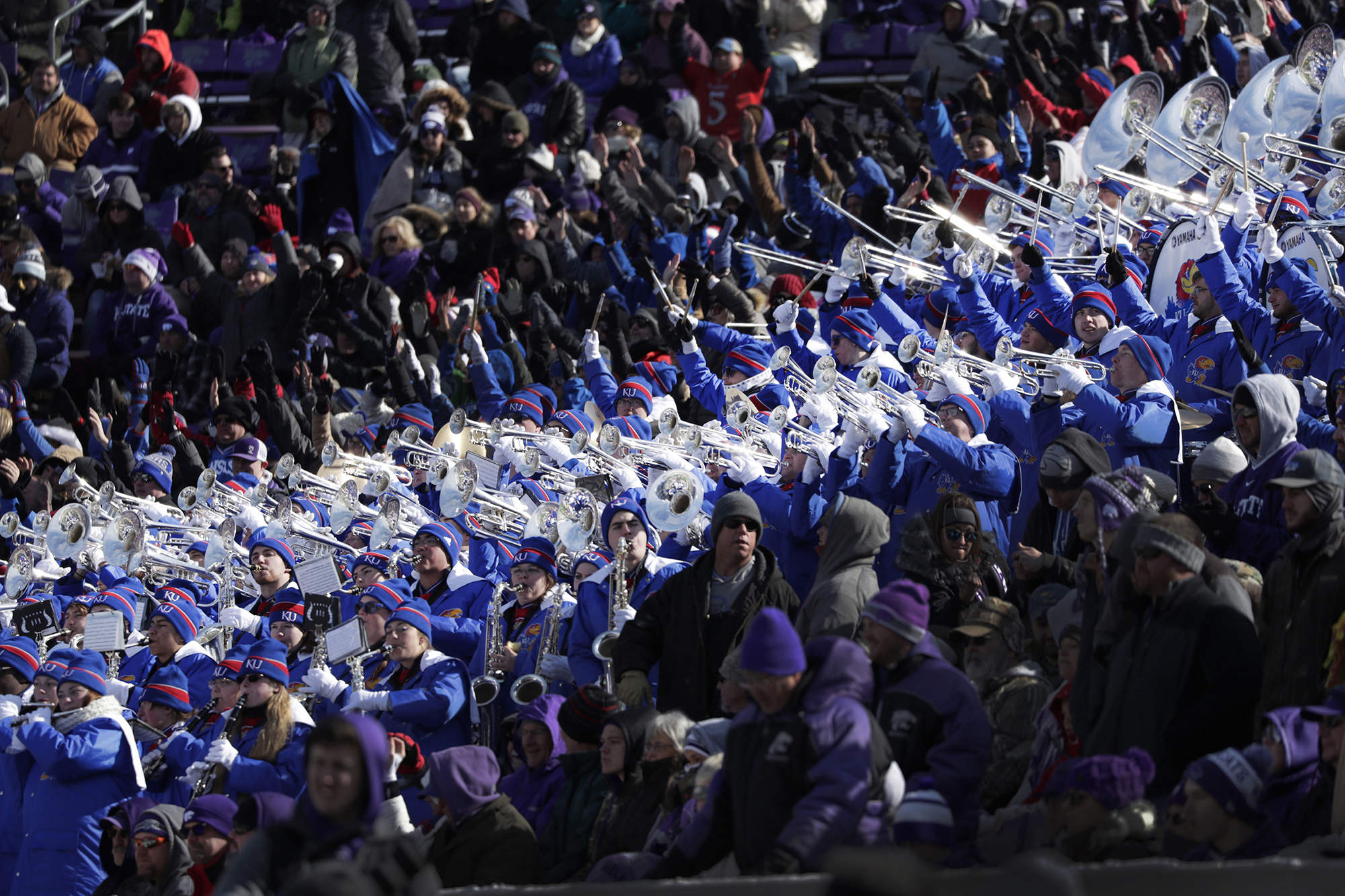 SWATH – In the midst of blue and purple-clad fans, a swath of brightly chromed instruments held by white-gloved members of the Kansas Marching Jayhawks stood out in the late afternoon sun as KU and Kansas State battled in the Dillons Sunflower Showdown inside Bill Snyder Family Stadium in Manhattan, Kansas on Saturday, November 10.