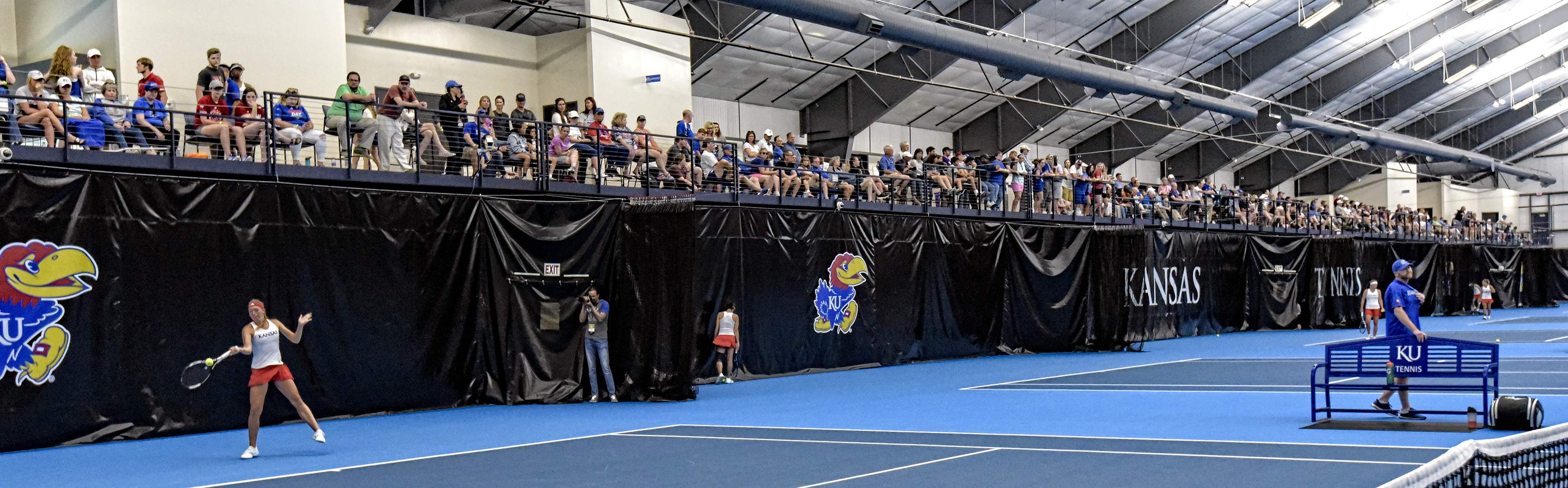 Fans pack the Jayhawk Tennis Center.