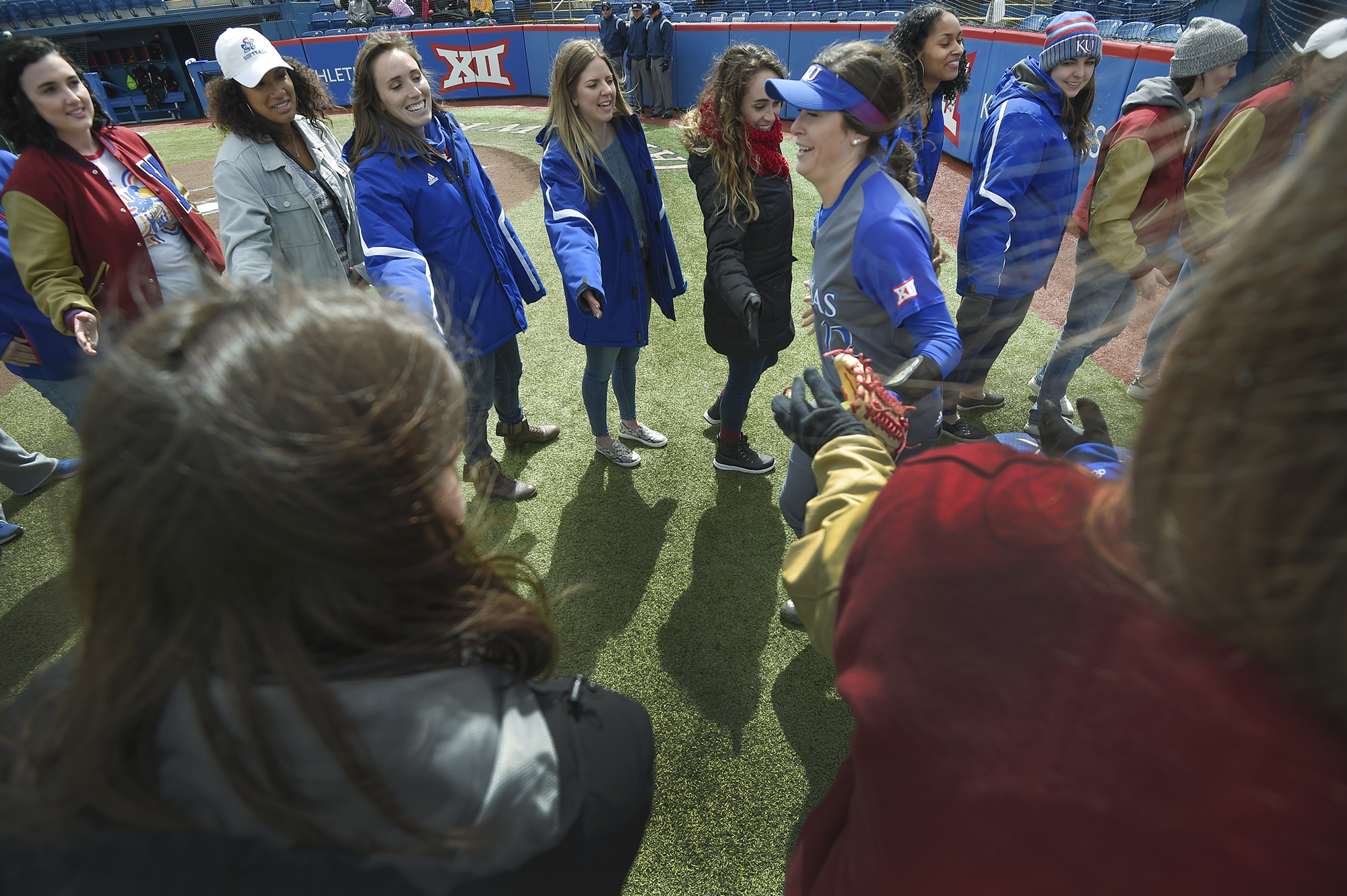 NEW AND OLD – SR Brynn Minor ran through a tunnel of KU softball alums before the game against Baylor on Saturday, March 30.