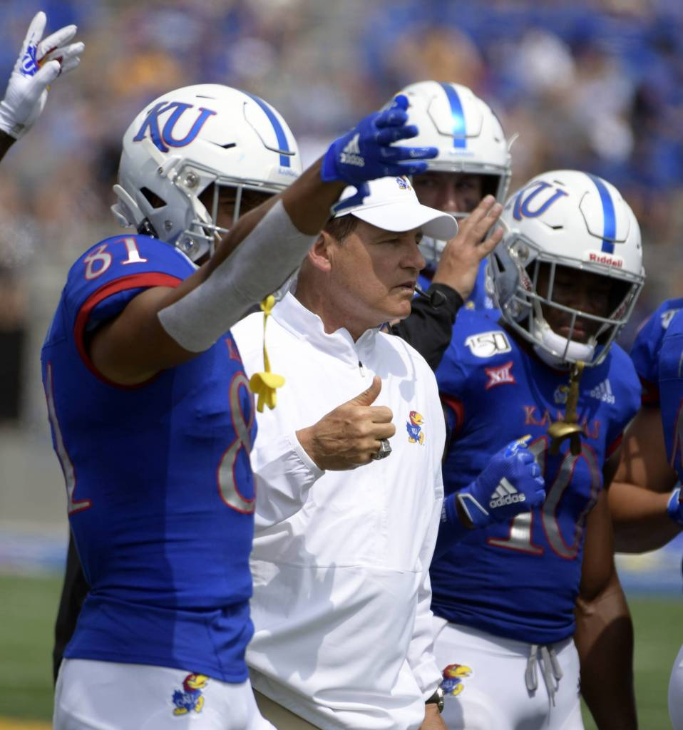 Les Miles celebrates during a game with some of his players.