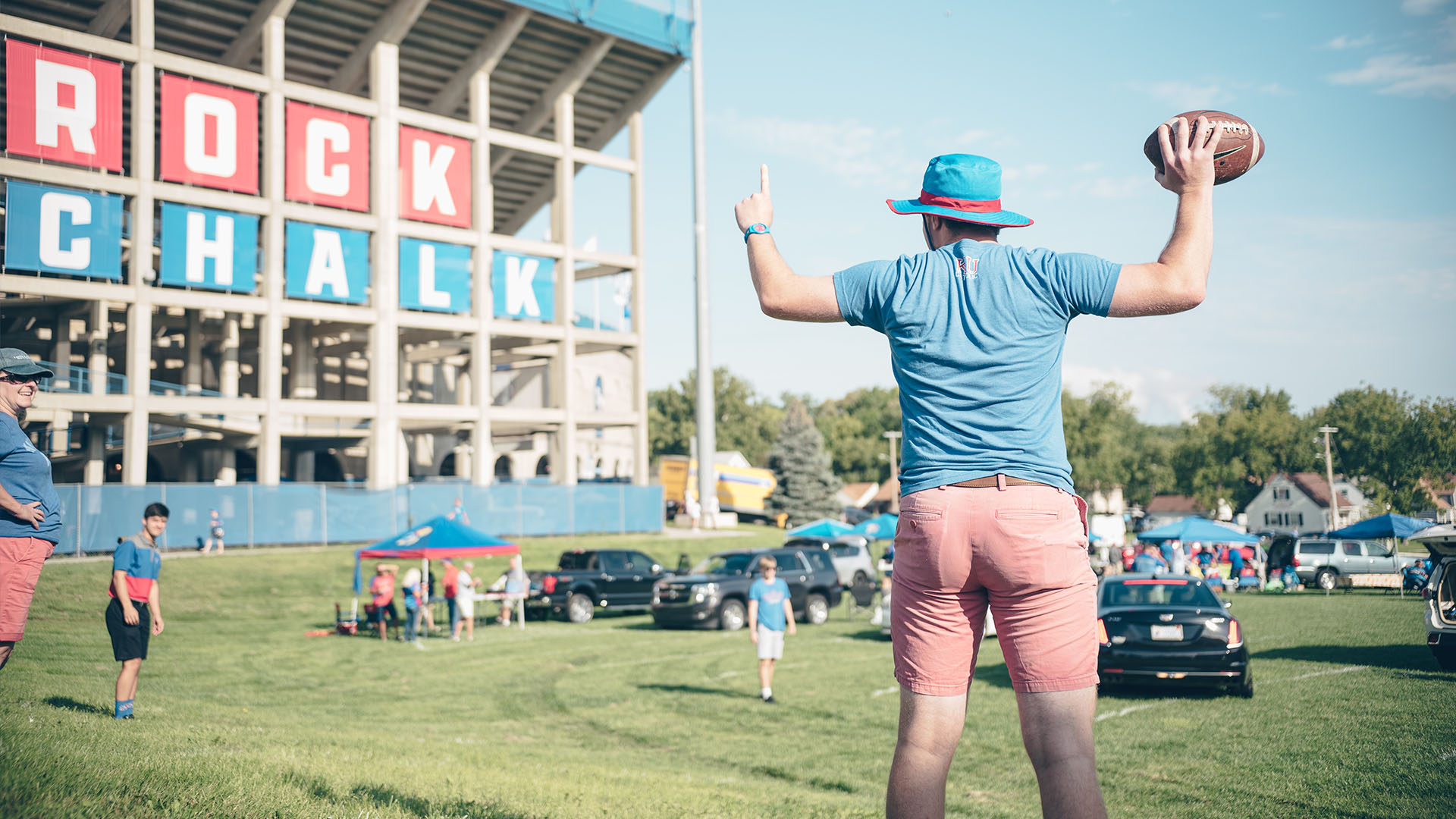 guy throws football tailgate indiana state