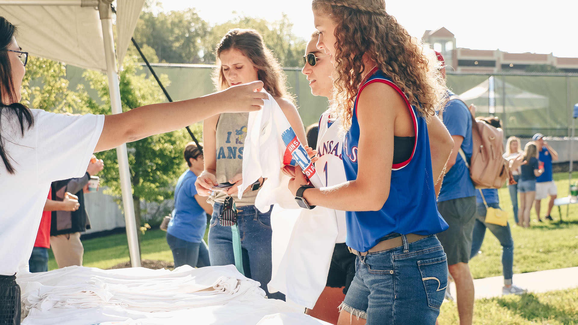 student tailgate indiana state grabbing shirts